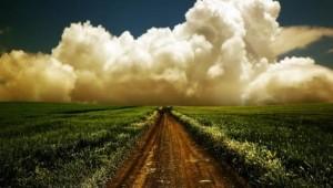 Clouds-over-a-grass-field-wallpaper_6627